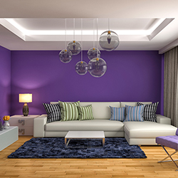Home Improvement Trends - Deep purple room, with pendant lights and wood floors.