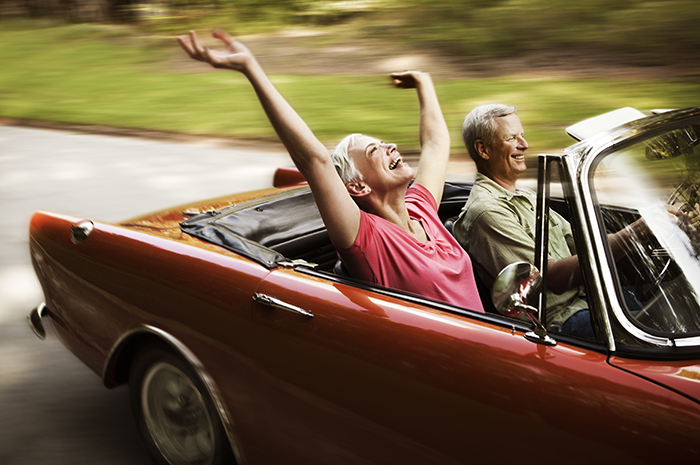 Buy a Used Car - Senior couple taking a classic convertible out for a spin before purchasing.