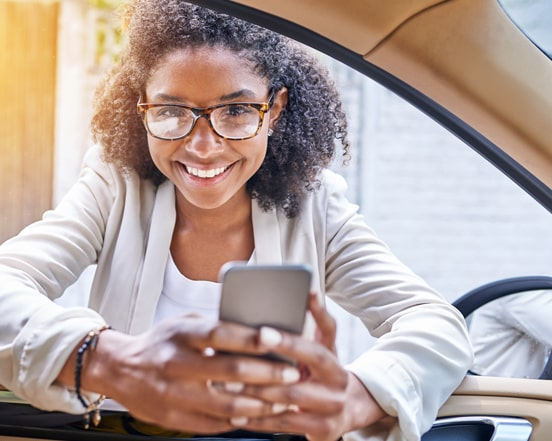 Woman with phone in car window
